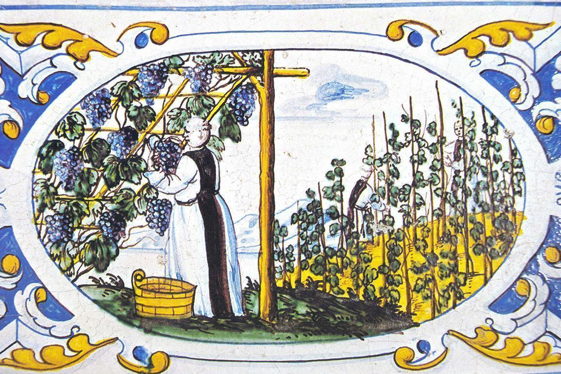 Mönch bei der Weinlese, Motiv auf dem Kachelofen im Sommerrefektorium von Salem; Foto: Staatliche Schlösser und Gärten Baden-Württemberg, Urheber unbekannt